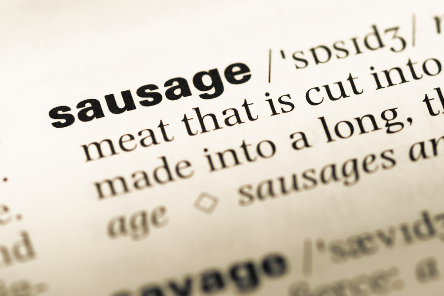Close Up Of Old English Dictionary Page With Word Sausage.