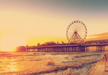 RETRO PHOTO FILTER EFFECT: Blackpool Central Pier at Sunset with Ferris Wheel, Lancashire, England UK.