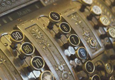 Vintage cash register keys closeup selective focus