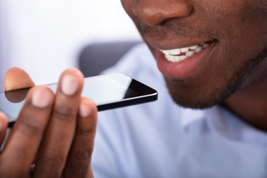Close-up Of a Man Using Voice Assistant On Cellphone.