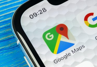 A mobile phone displaysthe Google Maps app.