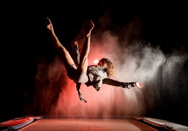 Bounce rate concept image. A woman bounces on a trampoline.