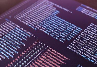 A screen shows a colourful script running as a concept of a third party script.